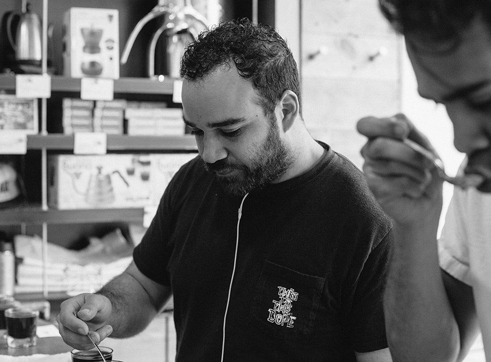 Mazi Razani cupping with the team at Blueprint Coffee.