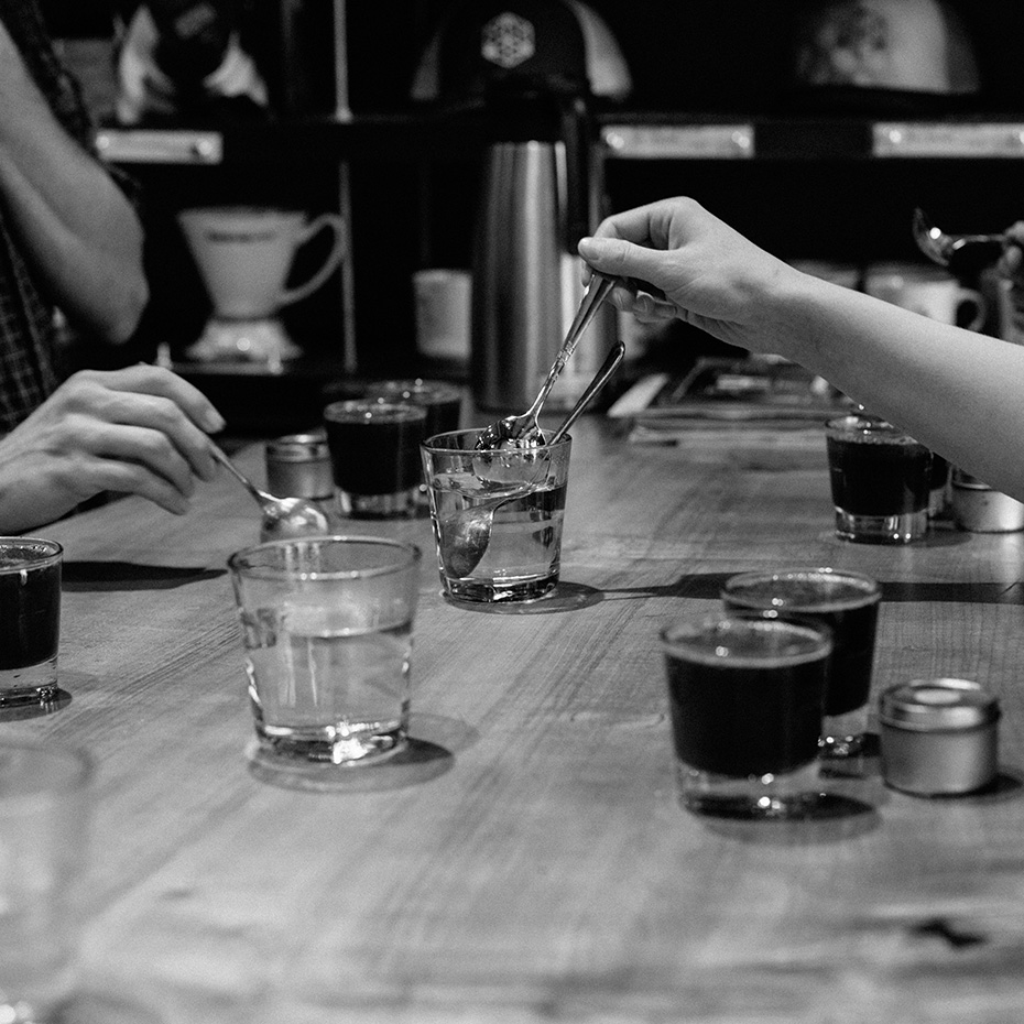 Tasters rinse their spoons between each coffee at a cupping.